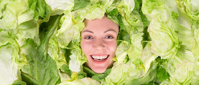 Woman Laughing With a Bowl of Salad